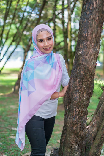 Portrait of lovely young Malay woman, modern stylish Muslim fashion, nature background. Selective focus. One Person Lifestyles Malaysia Malay ASIA Muslim Young Adult Attractive Fashion Modern Wood - Material Wood Forest Beauty In Nature Sky Tree Tranquility Stylish Style Plant People Real People Relaxing Close-up City Nature Mountain Day Hanging Out Growth Green Color Grass Travel Beautiful Portrait Looking At Camera Tree Trunk Three Quarter Length Trunk Smiling Leisure Activity Women Standing Casual Clothing Focus On Foreground Land Adult Outdoors Hairstyle