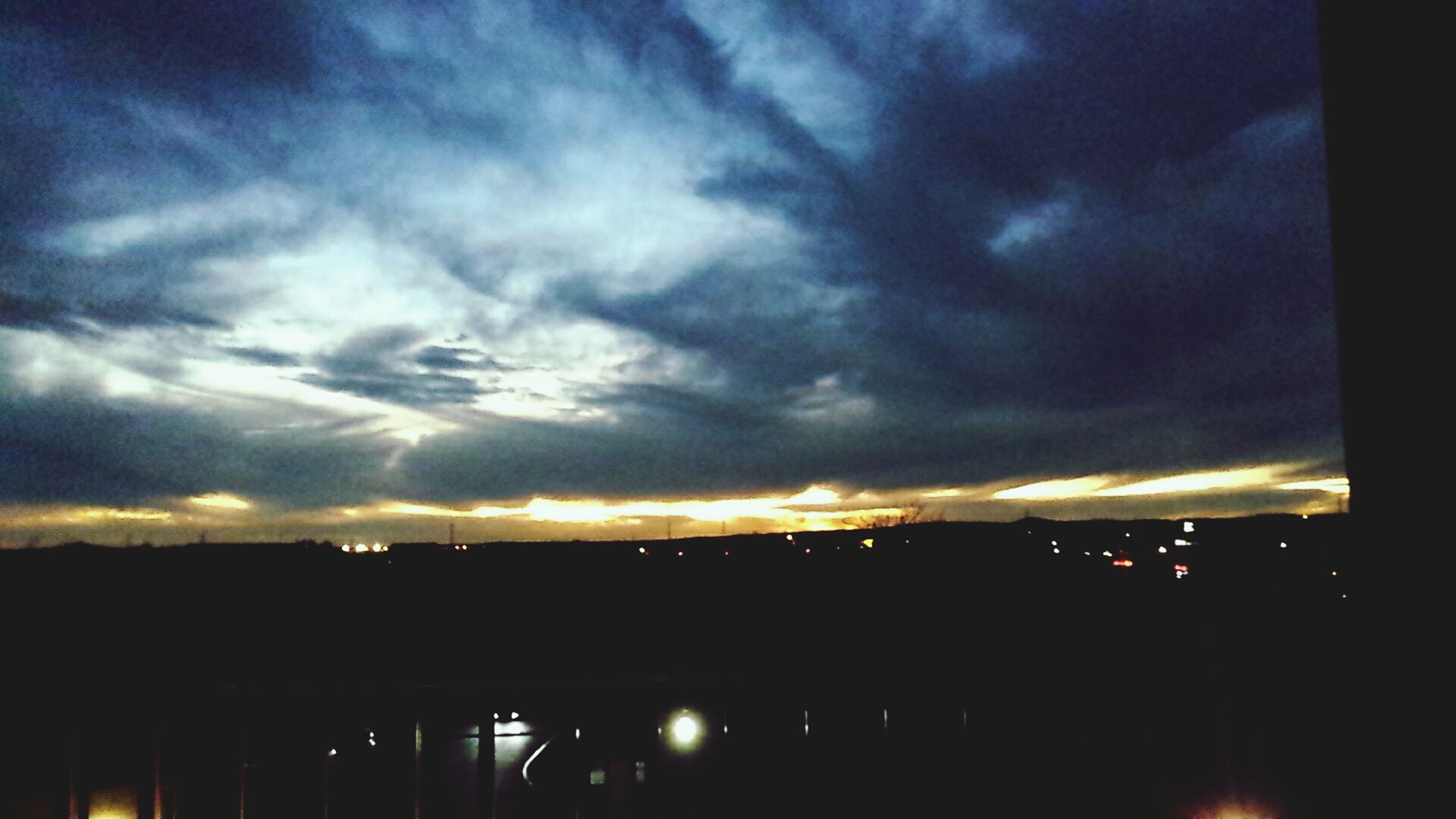 sky, sunset, cloud - sky, silhouette, built structure, architecture, cloudy, dramatic sky, illuminated, cloud, dusk, building exterior, dark, low angle view, storm cloud, weather, overcast, atmospheric mood, outdoors, nature