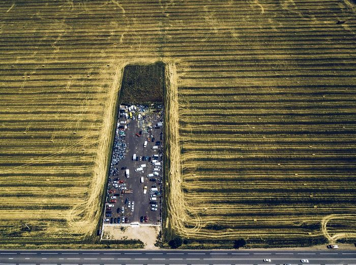 Aerial view of parking lot amidst farm