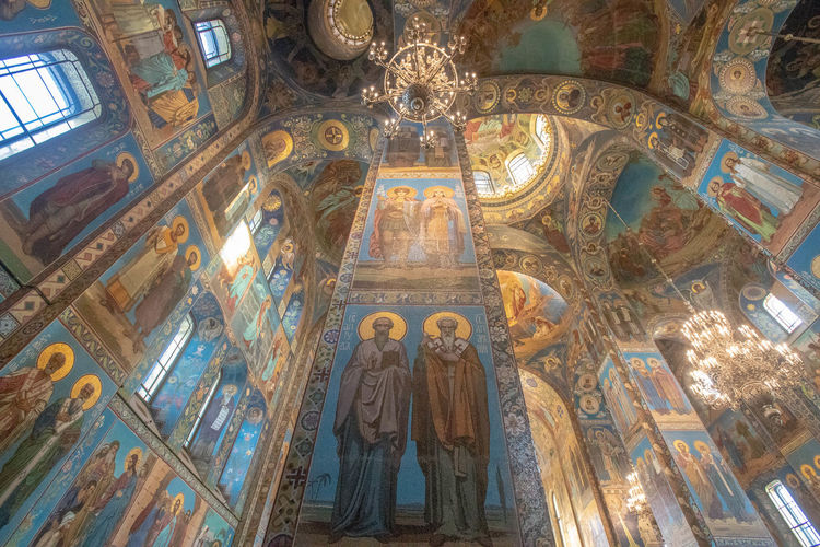 Religion Human Representation Representation Belief Low Angle View Architecture Art And Craft Place Of Worship Spirituality Male Likeness Indoors  Sculpture Female Likeness Built Structure Mural Statue Creativity Ceiling No People Cupola Altar