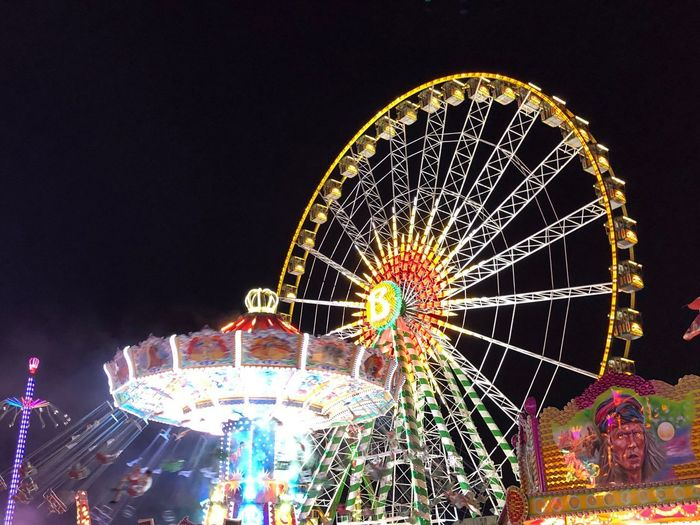 Iconic ferris wheel and chain carousel on Cranger Kirmes Funfair 2018 Cranger Kirmes  Ferris Wheel Chain Carousel Amusement Park Ride Amusement Park Arts Culture And Entertainment Illuminated Low Angle View No People Fairground Outdoors Enjoyment