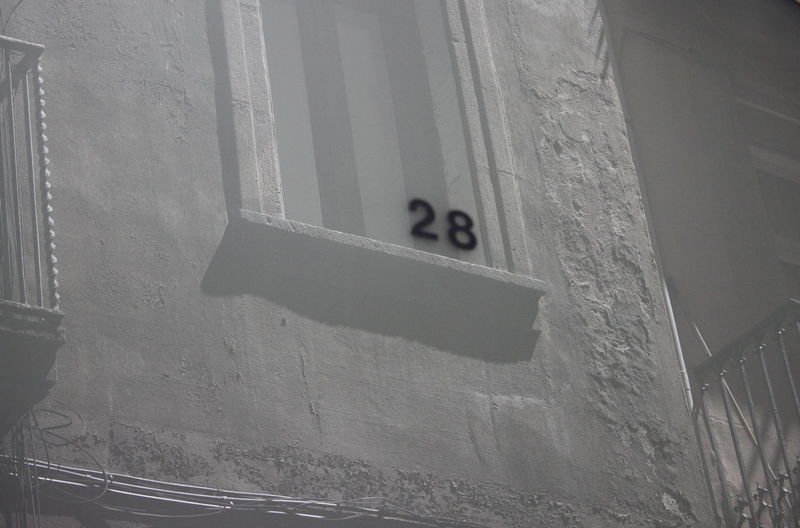 28 Barcelona June 2017 Architecture Balcony Cables Close-up Day No People Outdoors Street Number White Color Window
