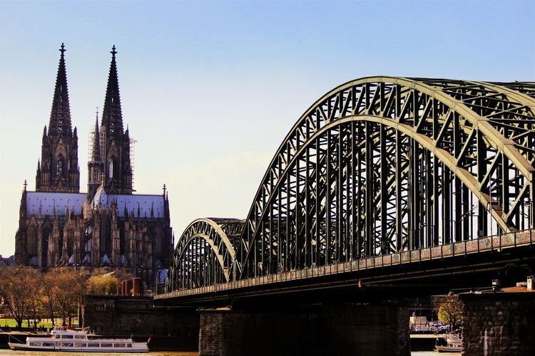 Architecture Blue Bridge - Man Made Structure Built Structure Capital Cities  City City Life Cologne , Köln,  Connection Culture Day Engineering Famous Place International Landmark Kölner Dom Cathedral Modern No People Outdoors Railway Bridge River Sky Tall - High Tourism Travel Destinations