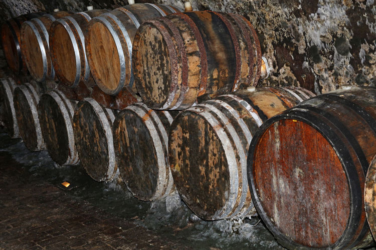 Stack of old barrels in wine cellar