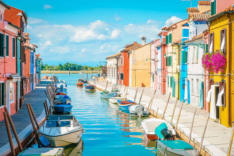 Architecture Building Exterior Built Structure Burano Canal City Cloud - Sky Color Colorful Day Incidental People Mode Of Transportation Moored Nature Nautical Vessel Outdoors Sea Sky Sunlight Transportation Travel Travel Destinations Venice Water Waterfront Wooden Post