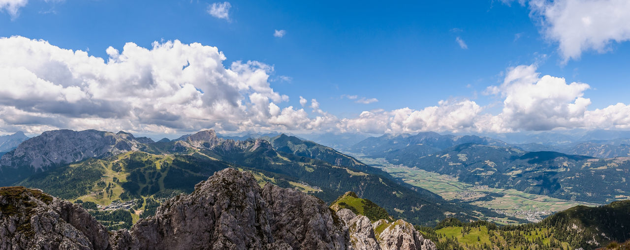 Mountain landscape with blue sky and clouds. Alps, Austria, Nassfeld. Scenics - Nature Sky Cloud - Sky Mountain Beauty In Nature Mountain Range Tranquil Scene Tranquility Landscape Environment Nature Panoramic No People Idyllic Non-urban Scene Day Outdoors Tree Rock Plant Mountain Peak