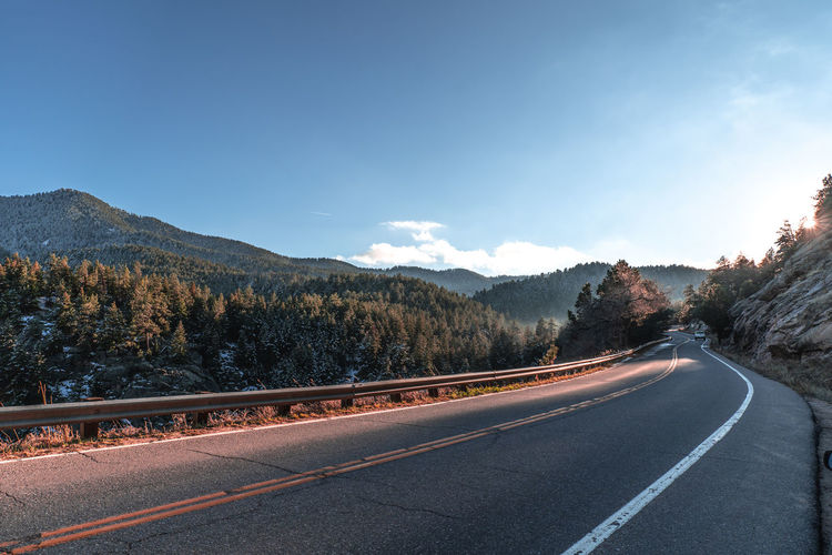 Boulder Colorado USA United States Mountains Road Sky Transportation Mountain Tree The Way Forward No People Nature Sign Beauty In Nature Direction Road Marking Scenics - Nature Tranquility Tranquil Scene Marking Symbol Plant Day Mountain Range Diminishing Perspective Crash Barrier Dividing Line