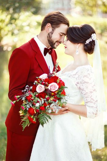 Newly Wed Couple Embracing In Marriage Ceremony