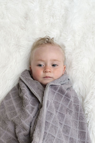 Baby Babyhood Bed Blond Hair Child Childhood Cute High Angle View Indoors  Innocence Looking At Camera Lying Down One Person Portrait Real People Relaxation Softness Toddler  Warm Clothing Young