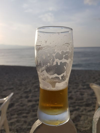End of the summer. Calabria Summer Seascape Bier Sea Frothy Drink Alcohol Drink Beach Cold Temperature Drinking Glass Sand Water Beer Glass Lager
