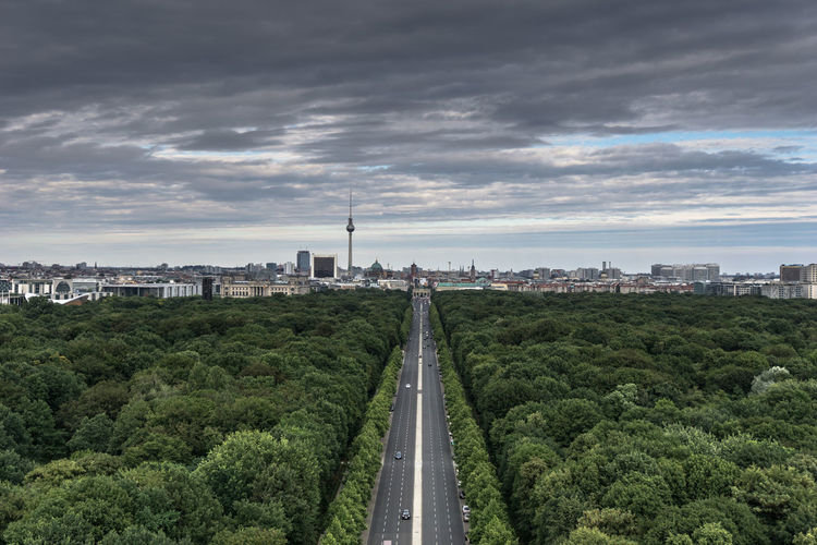 Architecture Berlin Built Structure City City Life Cityscape Cloud Cloud - Sky Cloudy Day Diminishing Perspective Dramatic Sky Grass Growth Nature No People Outdoors Overcast Road Sky Skyline The Way Forward Travel Destinations Tree Vanishing Point