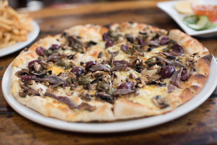 Pizza Baked Close-up Food Food And Drink Freshness Indoors  Indulgence No People Pizza Plate Ready-to-eat Selective Focus Serving Size Table Temptation Unhealthy Eating