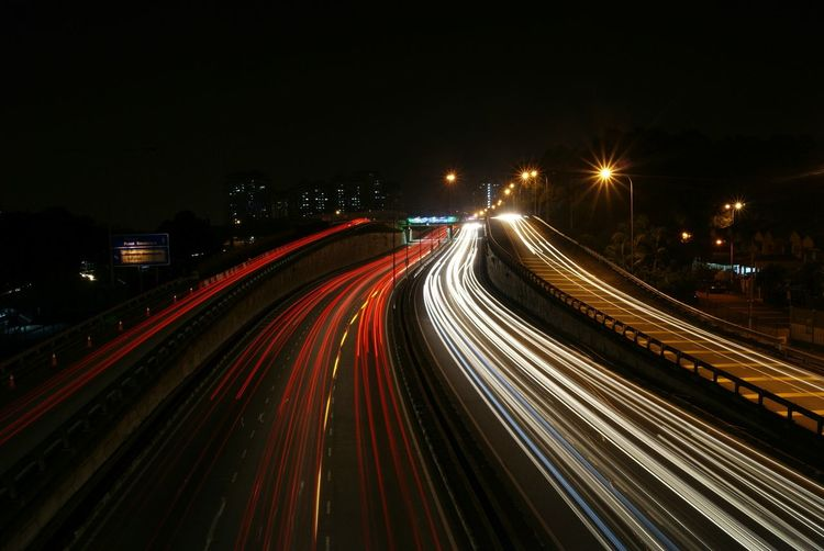 Capturing Motion Night Long Exposure Illuminated Transportation Light Trail Traffic City Life City Speed Motion Street Light Car High Angle View Highway Red Horizontal Outdoors Rush Hour No People Cityscape