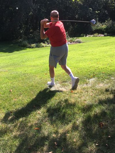 Backyard Golfer Ball Casual Clothing Full Length Golf Club Golf Swing Leisure Activity Norwell, Massachusetts One Person Outdoors Taking A Shot - Sport What Form?