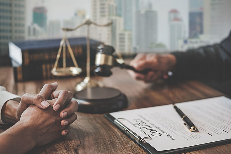 Judge sitting with client at table in office