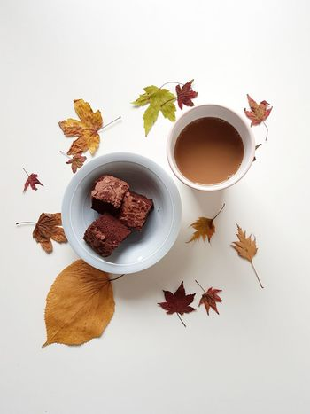 Teatime and autumn vibes Tea Time Coffee Barista Caffeine Cup White Background Leaves Autumn Indoors  EyeEm Best Shots Cake Brownies Porcelain  Table The Week On EyeEm Colorful Interior Design Free Time Leisure Activity No People Looking Down Multi Colored Maple Leaf Nature Large Group Of Objects
