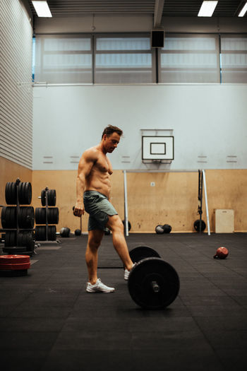 Shirtless Man Exercising In Gym