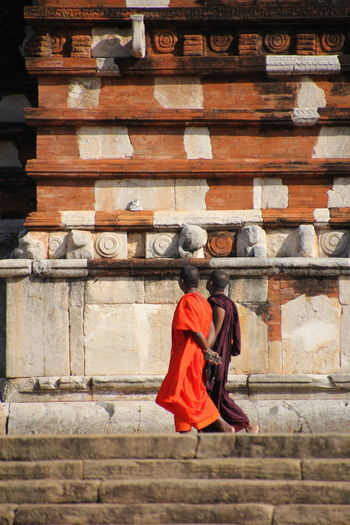 Low angle view of monks walking by temple