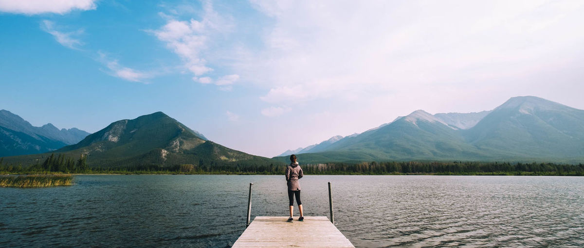 Lost In The Landscape Beauty In Nature Cloud - Sky Day Full Length Lake Leisure Activity Lifestyles Mountain Mountain Range Nature One Person One Woman Only Only Women Outdoors Real People Scenics Sky Standing Tranquil Scene Tranquility Vacations Water Women Young Adult Young Women
