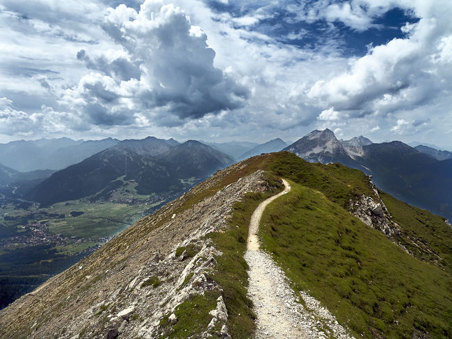 Up the way to the Zugspitze Footpath Road Ahead Beauty In Nature Cloud - Sky Day Environment Future Green Color Idyllic Landscape Mountain Mountain Peak Mountain Range Nature No People Non-urban Scene Outdoors Plant Scenics - Nature Sky Tranquil Scene Tranquility Way Ahead Way Forward A New Beginning