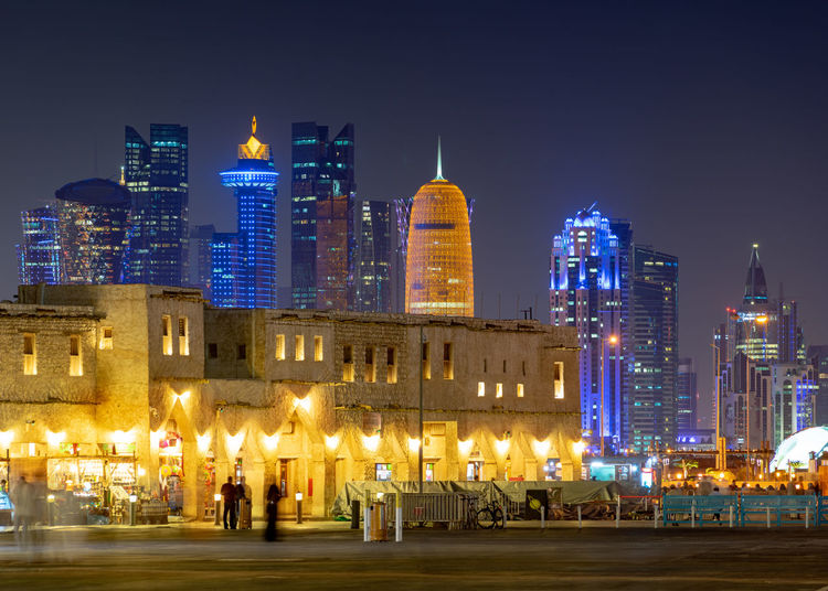 Building Exterior Architecture Illuminated City Night Cityscape Skyscraper Travel Destinations Doha Qatar Gulf Souq Waqif Bazar Market Old And New Heritage Skyline Shops Shopfronts