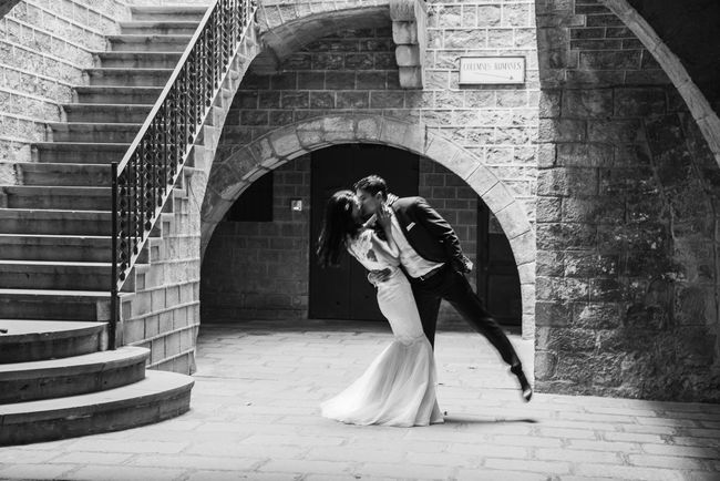 Arch Architecture Blackandwhite Bride And Groom Bridegroom Built Structure Groom Kiss Kisses Kissing Lifestyles Light And Shadow Lighting Love Love ♥ Outdoors Romantic Togetherness Two People Wedding Wedding Day Wedding Dress Wedding Photography Weddings Around The World Women
