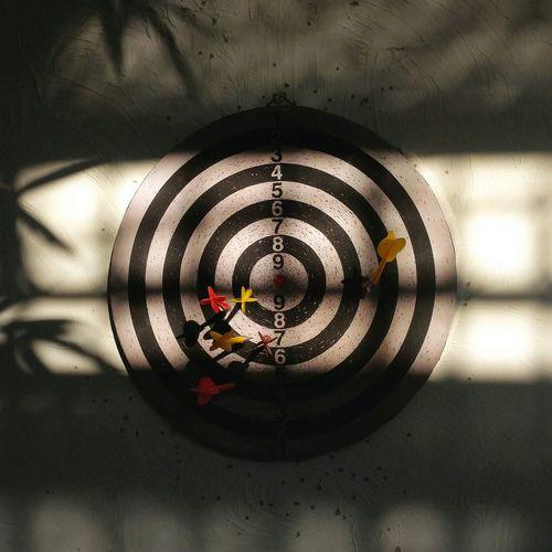 View of darts in dartboard