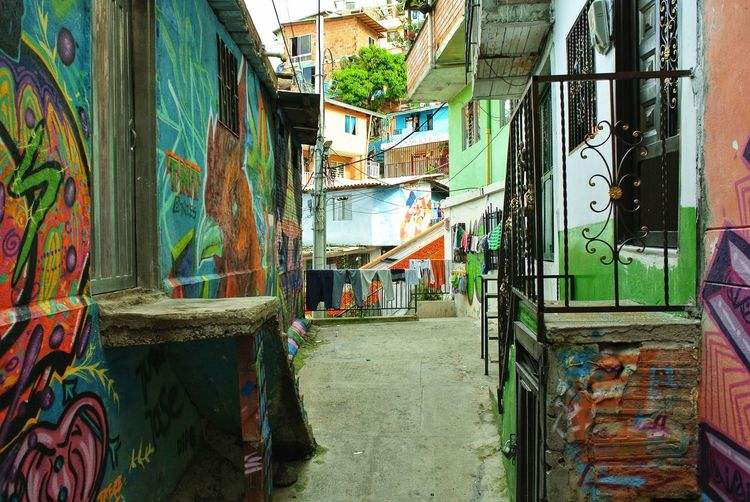 Comuna 13, Medellin. 🇨🇴 Art is Everywhere Hood Travel Clothes Escalator Streetart Streetphotography Colorful Art Arts Culture And Entertainment Colombia Medellín Comuna 13 Barrio San Javier Antioquia Paisa City Graffiti Architecture Building Exterior Built Structure Street Art Spray Paint Aerosol Can Building Historic Spray Bottle Exterior Lane