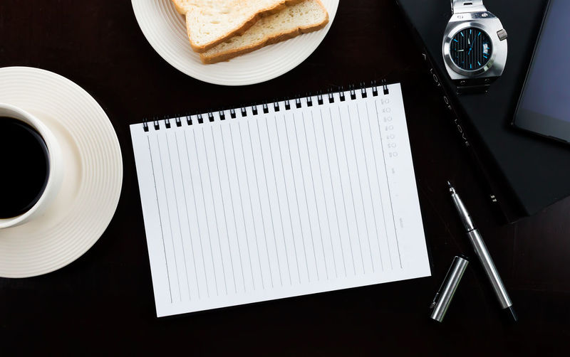 High angle view of spiral notebook on table
