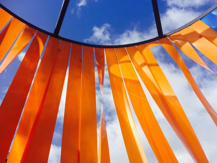 Low angle view of decoration hanging against blue sky