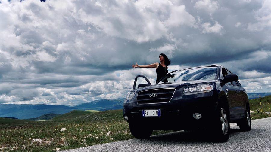Vintage car on mountain against sky