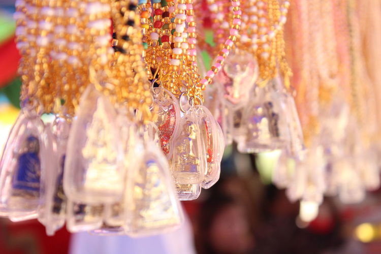 Amulets Amulets Lovers, Charms Belief In Thailand Faith Belief And Faith Believe Choice Close-up Creativity Faithful Focus On Foreground For Sale Ism Jewelry Market Multi Colored No People Selective Focus Variation