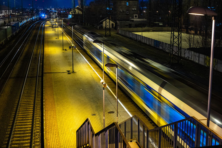 High angle view of train at railroad station during night
