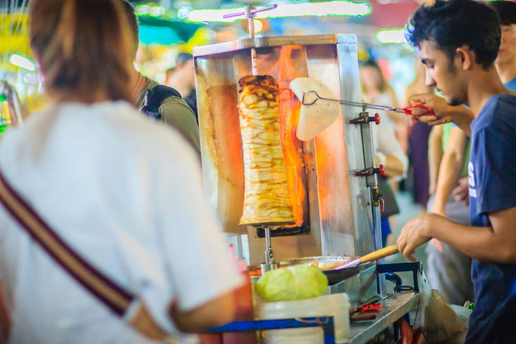 Bangkok, Thailand - March 2, 2017: Street vendor is selling grilled kebab, the popular street foods at Khao San Road night market, Bangkok, Thailand. Grilling Kebab Meat Kebabs Khao San Rd Khao San Road KhaoSan Khaosan Rd. Khaosandroad Tourist Tourist Attraction  Tourists Adult Business Buying Choice Consumerism Customer  Food Food And Drink Freshness Group Of People Healthy Eating Kebab Kebab Shop Kebabers Khao San Khao San Knok Wua Khao San Rd. Khaosan Road Khaosanroad Lifestyles Market Market Stall Men Night Market Night Market In Thailand Night Market, People Real People Retail  Selective Focus Shopping Store Tourist Destination Women