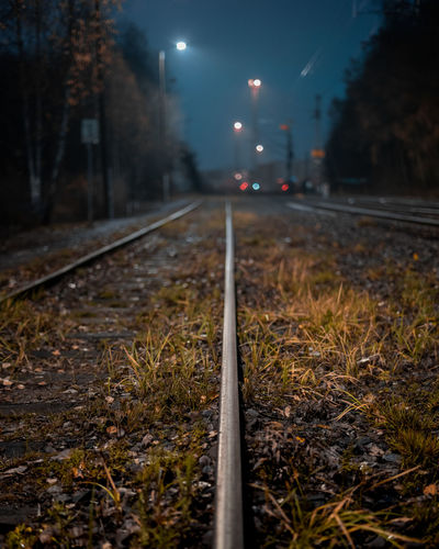 Surface level of railroad tracks on street at night