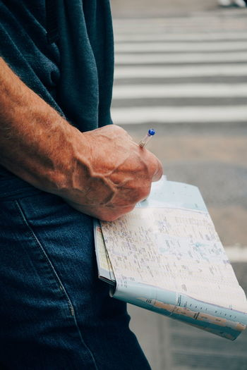 Close-up of man holding book