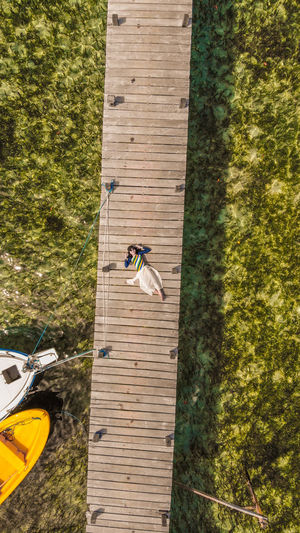 High angle view of man climbing on tree