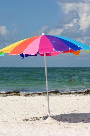 Beach Beach Umbrella Cloud Coastline Gulf Of Mexico Horizon Over Water Madeira Beach Florida Multi Colored Outdoors Saint Petersburg Florida Scenics Sea Shore Sky Tampa Bay Water