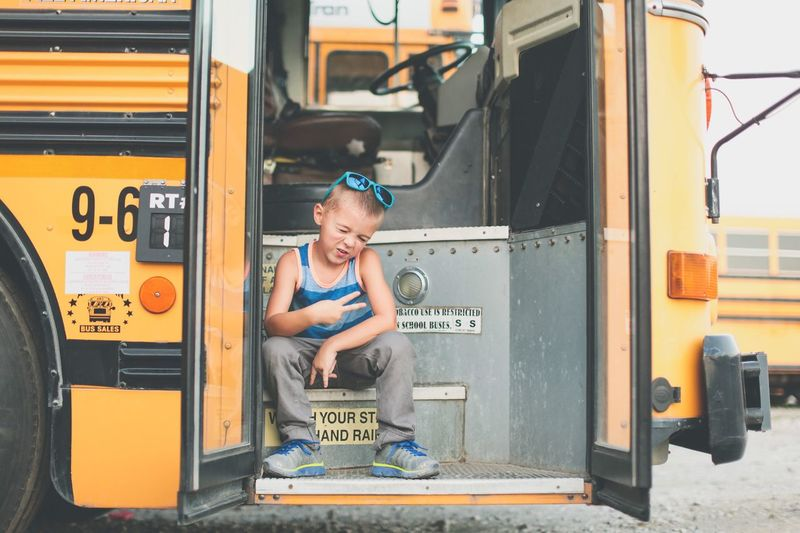 School bus fun. One Person Smiling Full Length Text Happiness Outdoors Real People People Day Adult