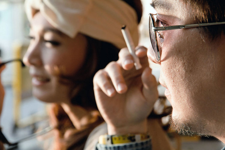 A shot of a young couple dating outdoor Couple Couple - Relationship Couple In Love Asian Girl Asian People Thai Lifestyles Man Girl Women Portrait Headshot Young Adult Real People Close-up Dating Smoking Cigarette  Smoke Holding Men Indoors  Focus On Foreground Glasses Adult Eyeglasses  Males  Concentration People Two People Selective Focus Human Body Part Human Face