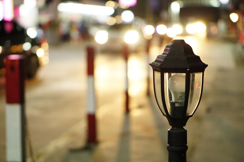 Illuminated Lighting Equipment Night No People Focus On Foreground Street Light Close-up Outdoors City Light Bulb Lamp Post Street EyeEmNewHerе Streetphotography Night Life 🌛 Night Market Night Market In Thailand Bokeh Bubbles Bokehphotography Bokeheffect