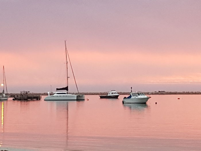 EyeEm Selects Sunset Nautical Vessel Landscape Sea Tranquility Water Harbor Reflection Beach Sky Recreational Boat Pink Color No People Scenics Travel Destinations Blue Outdoors Sailboat Vacations Horizon Over Water