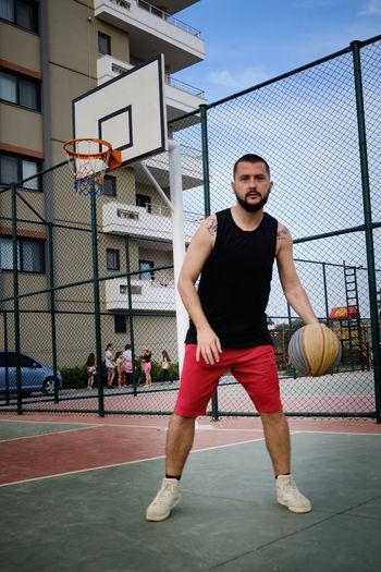 Portrait of man playing basketball