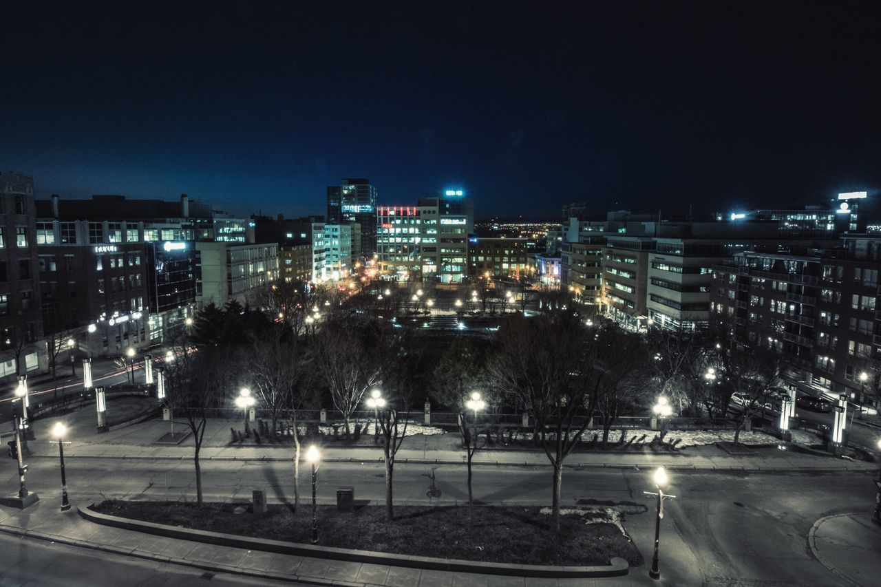night, illuminated, building exterior, architecture, high angle view, city, built structure, outdoors, no people, cityscape, street light, tree, road, sky, nature