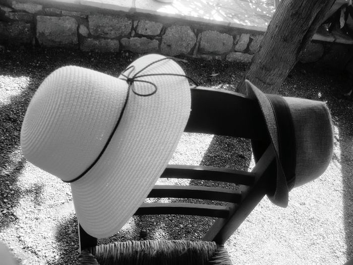 A couple sitting near but their hats looks so great together.... People Together Hats Chair Men Hat Woman Hat Blackandwhite Black And White Blackandwhite Photography Monochrome Two Is Better Than One Monochrome Photography