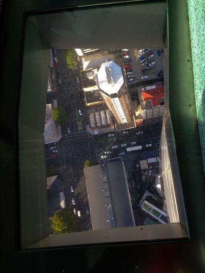 City street seen through glass window
