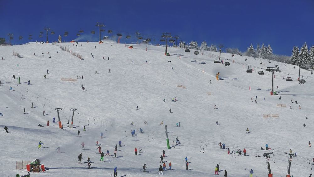 Skiing Large Group Of People Sport Day Crowd Adults Only Outdoors People Sky Adult Sports Event  Skiing Skiing ❄ Slope Ski Lift Tourism Tourist Destination Tourist Attraction  Ski Resort  Snow Sports