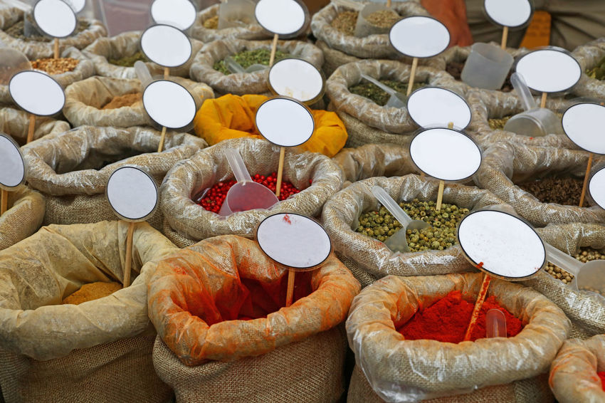 Variety of spices in bags with price tags at retail display of market stall Choice Copy Space Market Peppercorns Price Tag Abundance Bag Close-up Day Food Stories For Sale Ingredient Label Market Stall No People Paprika Pepper Retail  Retail Display Seasoning Spices Spices Of The World Trade Variety