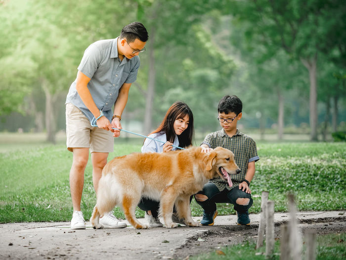 Family with dog at park
