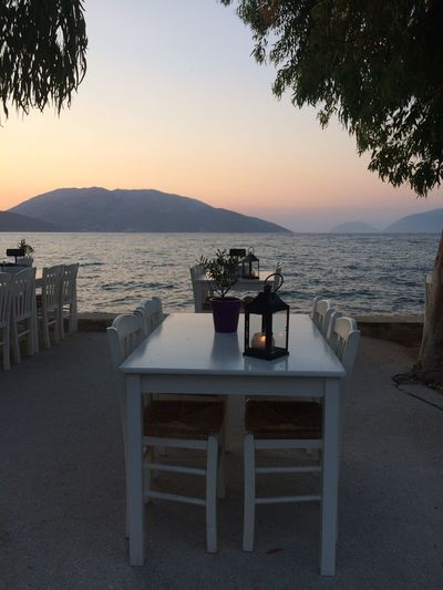 Sami Cefalonia Grecia Table Sea Sunset Water Chair Place Setting Food And Drink Restaurant Nature Beach Scenics Outdoor Cafe Tranquility Drink Sky Horizon Over Water No People Outdoors Plate Beauty In Nature Femalephotographerofthemonth 43GoldenMoments